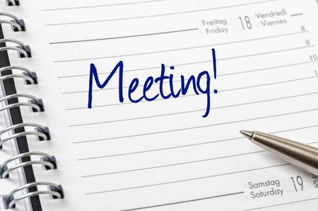 Meeting written on a calendar page photo