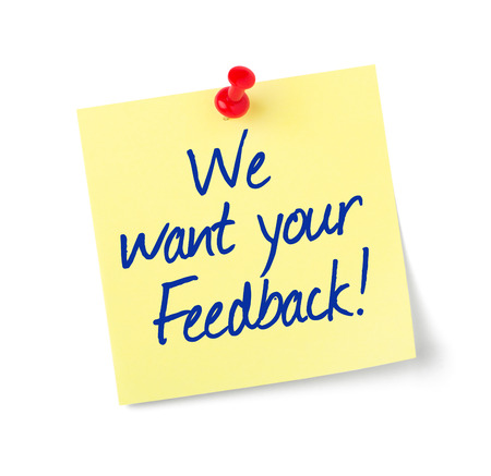Paper note with text We want your Feedback Standard-Bild