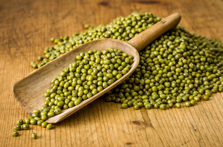 Wooden scoop with mung beans photo