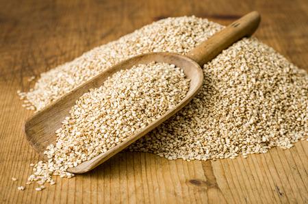 wooden scoop: Wooden scoop with sesame seeds