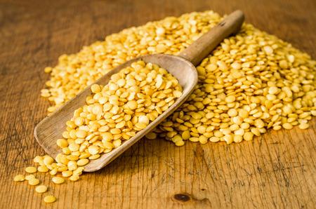 wooden scoop: Wooden scoop with yellow lentils