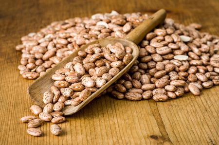 wooden scoop: Wooden scoop with pinto beans
