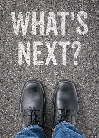 what's ahead: Text on the floor - Whats next Stock Photo