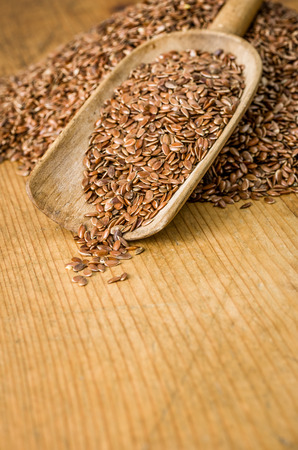 organic flax seed: Wooden background with copy space - Flax seeds Stock Photo