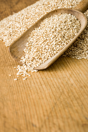 sesame seeds: Wooden background with copy space - Sesame seeds Stock Photo
