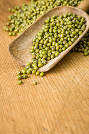 Wooden background with copy space - Mung beans photo