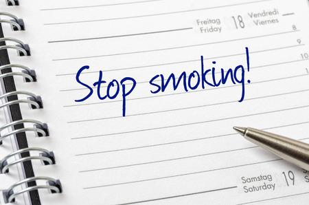 stop smoking: Stop smoking written on a calendar page Stock Photo