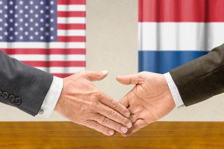 representatives: Representatives of the USA and the Netherlands shake hands