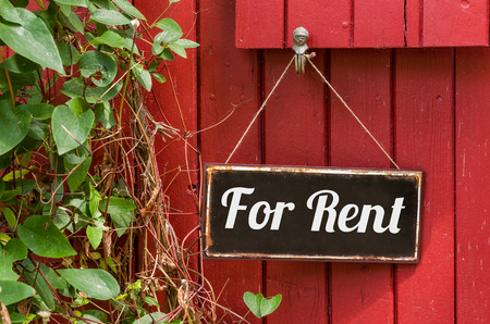 Old metal sign with the inscription For Rent photo