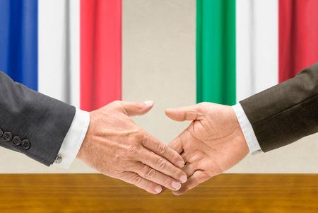 representatives: Representatives of France and Italy shake hands Stock Photo