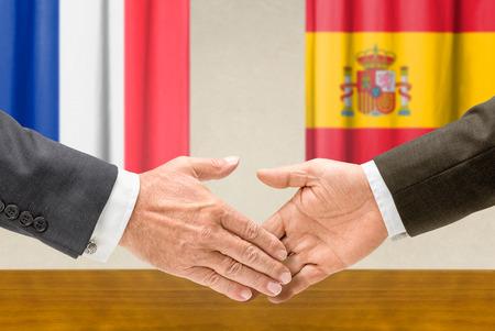 representatives: Representatives of France and Spain shake hands