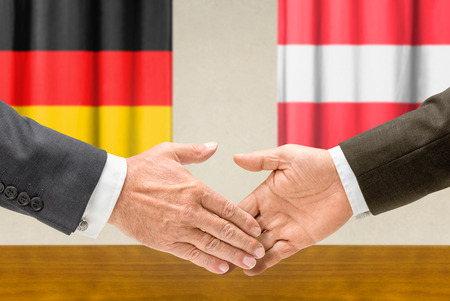 foreign policy: Representatives of Germany and Austria shake hands Stock Photo