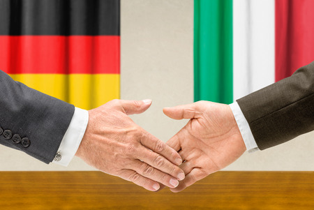 shake hands: Representatives of Germany and Italy shake hands Stock Photo