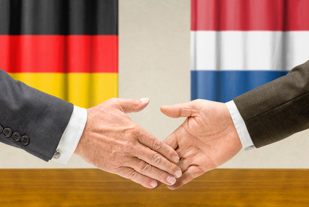 Representatives of Germany and the Netherlands shake hands photo
