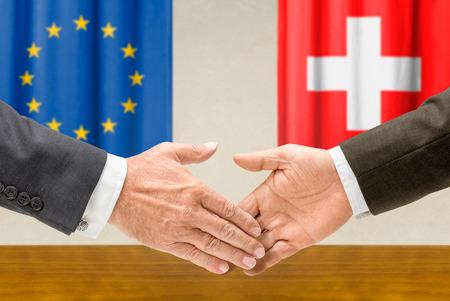 representatives: Representatives of the EU and Switzerland shake hands