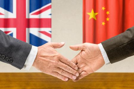 representatives: Representatives of the UK and China shake hands