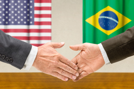 representatives: Representatives of the USA and Brazil shake hands