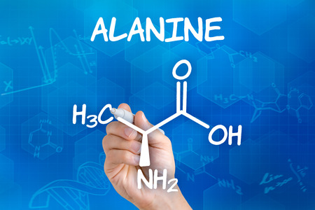 chemical formula: Hand with pen drawing the chemical formula of alanine