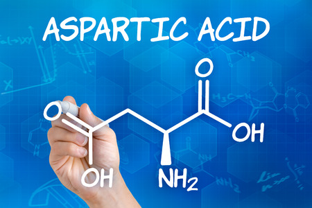 Hand with pen drawing the chemical formula of aspartic acid photo