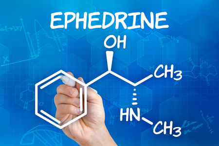 chemical formula: Hand with pen drawing the chemical formula of ephedrine Stock Photo