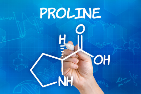 proline: Hand with pen drawing the chemical formula of proline Stock Photo