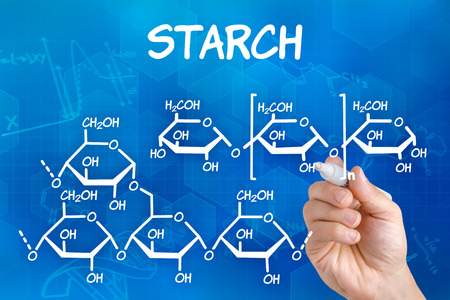 starch: Hand with pen drawing the chemical formula of starch