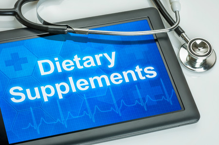 dietary supplements: Tablet with the text Dietary Supplements on the display Stock Photo