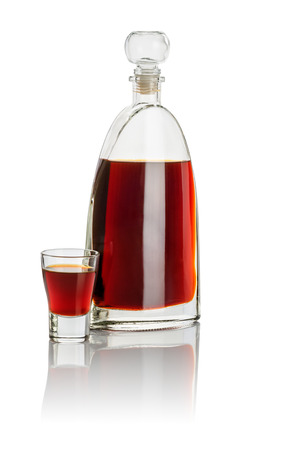 carafe: Carafe and shot glass filled with brown liquid
