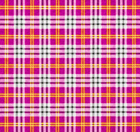 Fabric with a checked pattern in pink tones photo