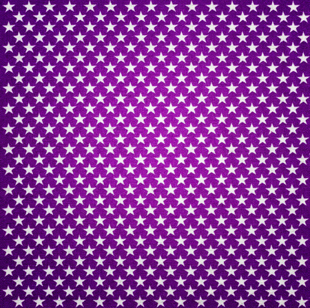 Purple fabric with white stars with vignette effect photo