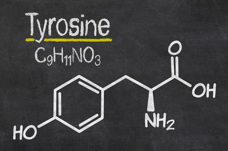 neurotransmitter: Blackboard with the chemical formula of Thyrosine Stock Photo