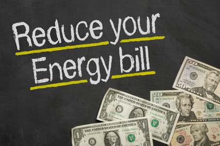 Text on blackboard with money - Reduce your energy bill Imagens - 36114882