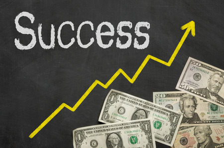 financial diversification: Text on blackboard with money - Success