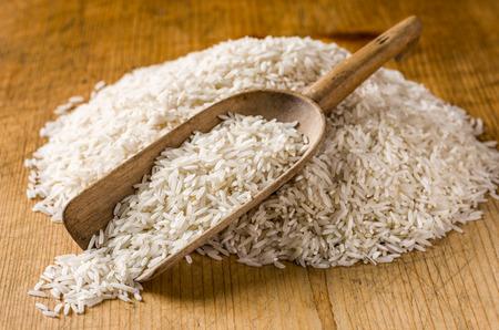 basmati: Wooden scoop with basmati rice