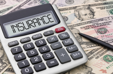 household accident: Calculator with money - Insurance