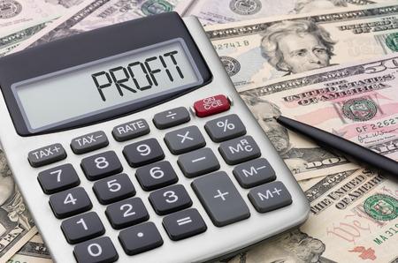 household money: Calculator with money - Profit Stock Photo
