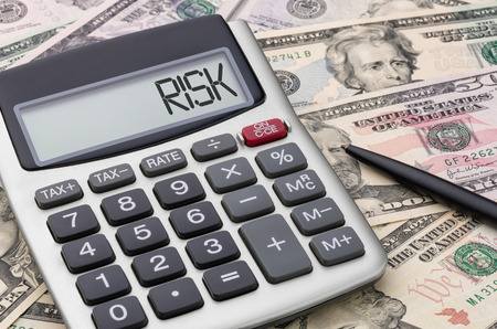 Calculator with money - Risk Stock Photo