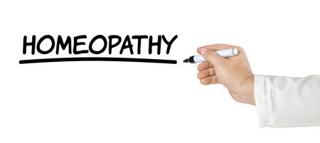 homeopatia: Mano con pluma de escribir Homeopat�a