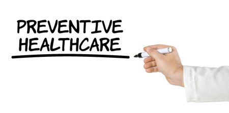 health care concept: Hand with pen writing Preventive Healthcare