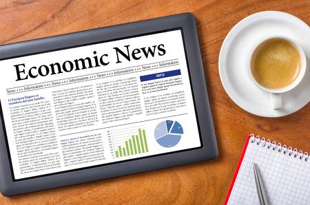 Tablet on a desk - Economic News photo
