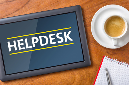 helpdesk: Tablet on a desk - Helpdesk Stock Photo
