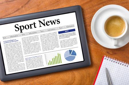 Tablet on a desk - Sport News Stock Photo