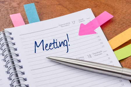 Daily planner with the entry Meeting photo