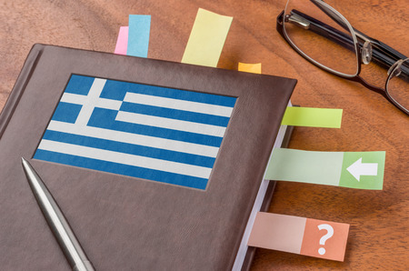 foreign policy: Notebook with the flag of Greece