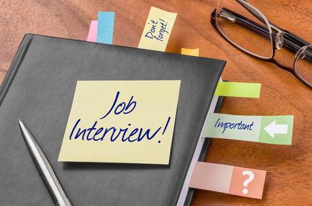 entrevista de trabajo: Planificador con nota adhesiva - Entrevista de trabajo