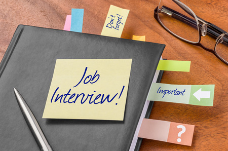 interview: Planner with sticky note - Job interview