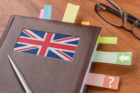 foreign policy: Notebook with the flag of the UK Stock Photo