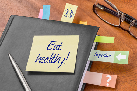 event planner: Planner with sticky note - Eat healthy