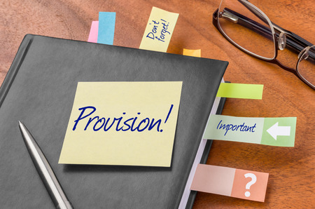 provision: Planner with sticky note - Provision Stock Photo