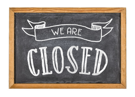 closed sign: Sign with the text We are closed Stock Photo